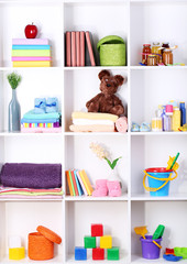 Beautiful white shelves with different baby related objects