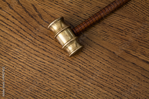 auction hammer on wooden desk