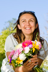 Happy laughing woman with flowers