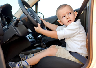 Little boy pretending to drive
