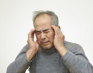 頭が痛い男性