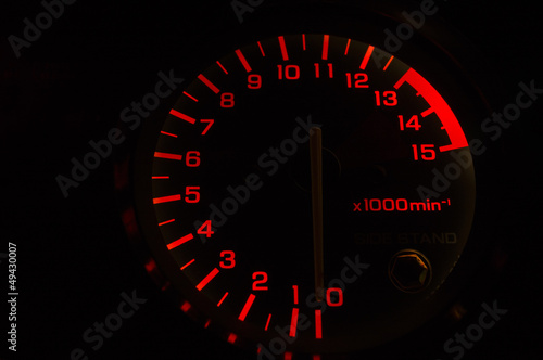 An automobile tachometer.