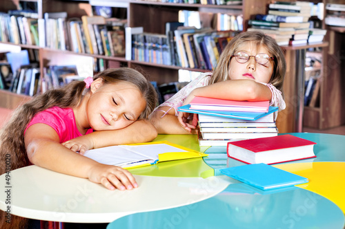 Kids asleep in a library