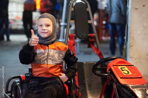 Happy little girl on karting