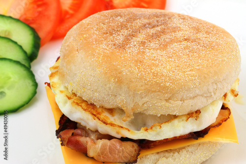 English muffin with bacon and egg and Cheddar cheese