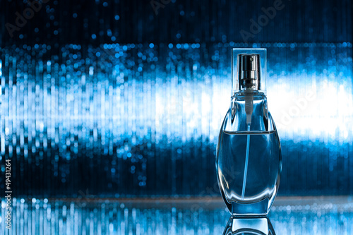 Perfume on blue background