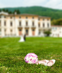 Wedding Shoes and Boquet in Ancient Villa