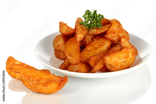 Appetizing village potatoes on plate isolated on white