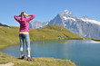 Traveler in the Alpine meadow. Jungfrau region, Switzerland