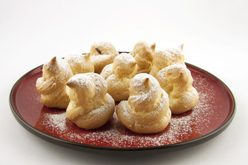 sweet profiteroles with powdered sugar