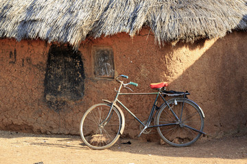 Mud huts and bike