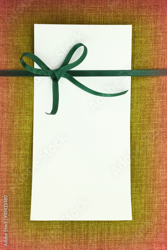 Empty card on fabric texture background