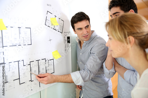 Architects in office looking at construction project