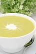 bowl of green pea soup with ginger and cream