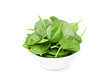 white bowl with fresh spinach isolated