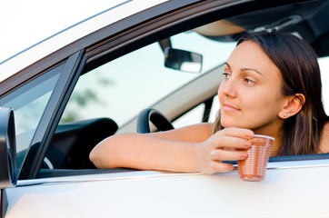 Woman waiting patiently in her car