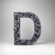 Letter D made out of scrambled small letters in studio setting