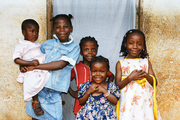 African kids all sisters smiling