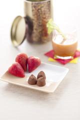 Chocolate truffles and fruit.