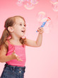 litle girl with soap bubbles