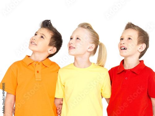 Portrait of the happy children looking up