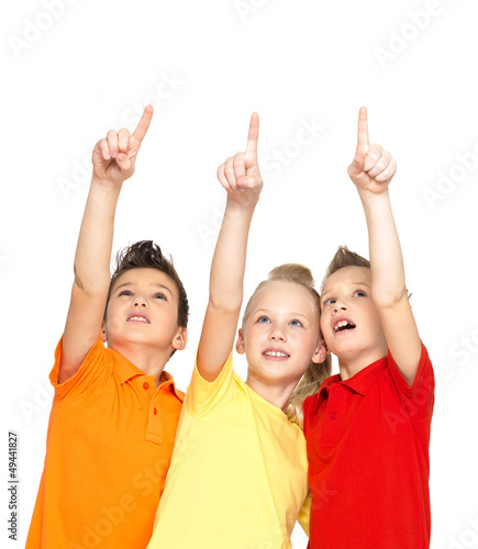 Portrait of the happy children point up  by finger - isolated on