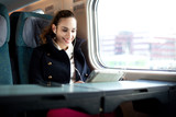 Young woman traveling on the train in business class