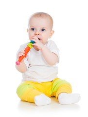 Funny baby  girl playing with musical toy. Isolated on white bac