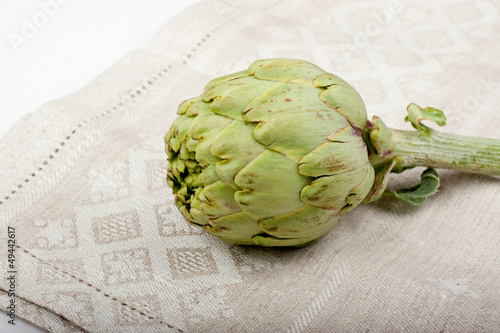 One artichoke on a dishcloth
