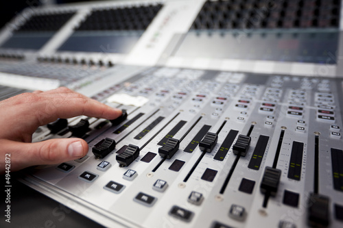 Hand on a sound fader in Television Gallery
