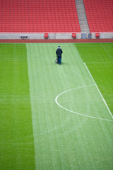 Groundsman working in stadium