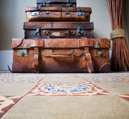 Stack of Old Leather Luggage on Tiled Floor