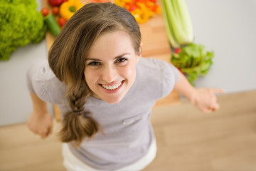 Portrait of happy young woman in kitchen
