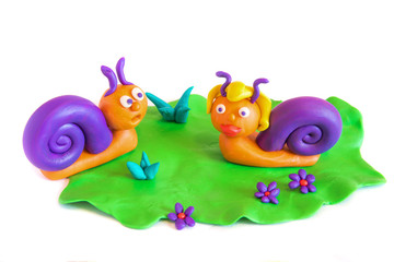 Two snails, clay modeling.
