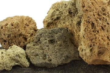 volcano stones on black sand