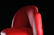 red sofa isolated on black background
