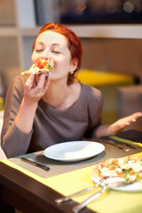 Woman eating a pizza