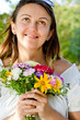 Smiling happy woman holding a floral bouquet