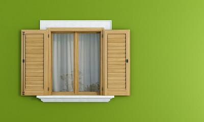 Wooden windows on green wall