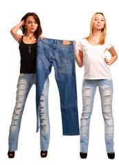 Trendy girls holding up outmoded denim jeans