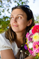 Thoughtful woman with beautiful flowers