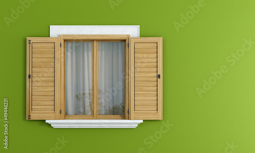 Wooden windows on green wall