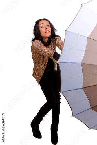 Woman struggling with an umbrella
