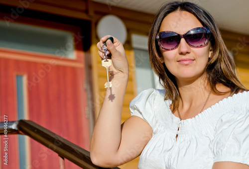 Woman holding a house door key