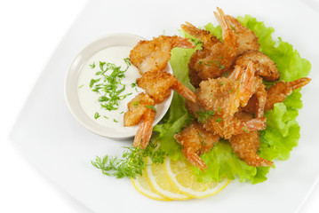 Fried prawns in coconut breading with dipping sauce