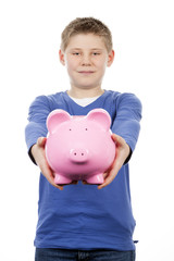 young boy with pink piggybank