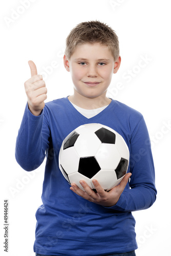 young boy holding a football ball