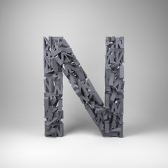 Letter N made out of scrambled small letters in studio setting