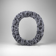 Letter O made out of scrambled small letters in studio setting