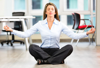 Business woman doing yoga
